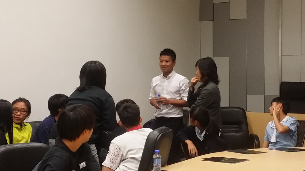 Director, Michael Luk and HK Football Manager Betty engaging the players.