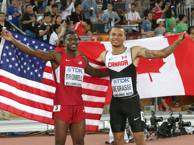Joint bronze winners Canada's Andre De Grasse (right), and United States' Trayvon Bromell (left) celebrate after the men's 100m at the world track and field championships.