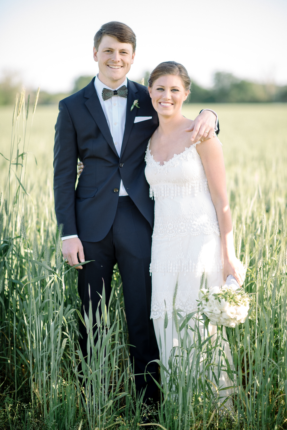 Mr. and Mrs. William Hunter Guerin! Yay!!!! Katie looked gorgeous in her Claire Pettibone dress, and Hunter looked so handsome with his Brackish Bow tie made with guinea feathers. Katie's cousin is the creator/owner of Brackish Bow Ties.