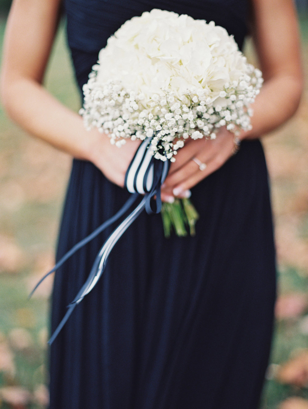 The bride loved baby's breath and wanted it incorporated in all of the bouquets.