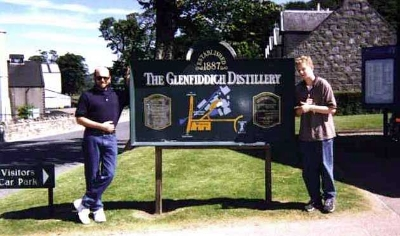 Now we're off to the Glenfiddich Distillery. Danny seems to be using the sign as a support.
