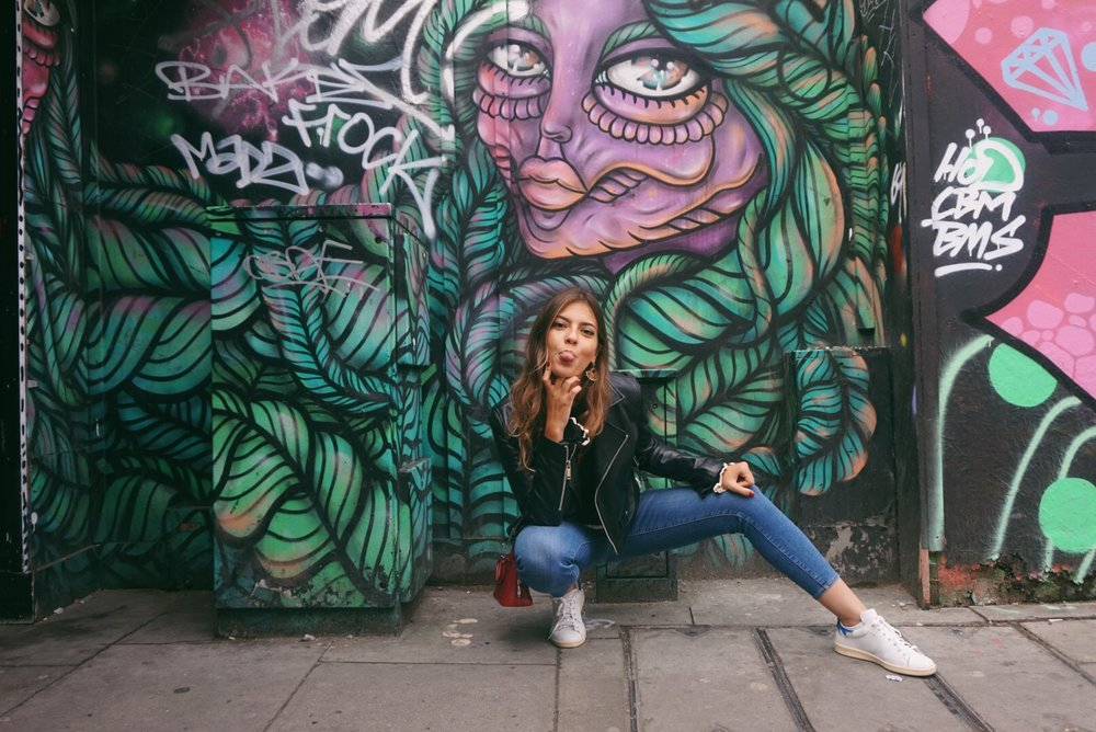 kneeling with graffiti.JPG