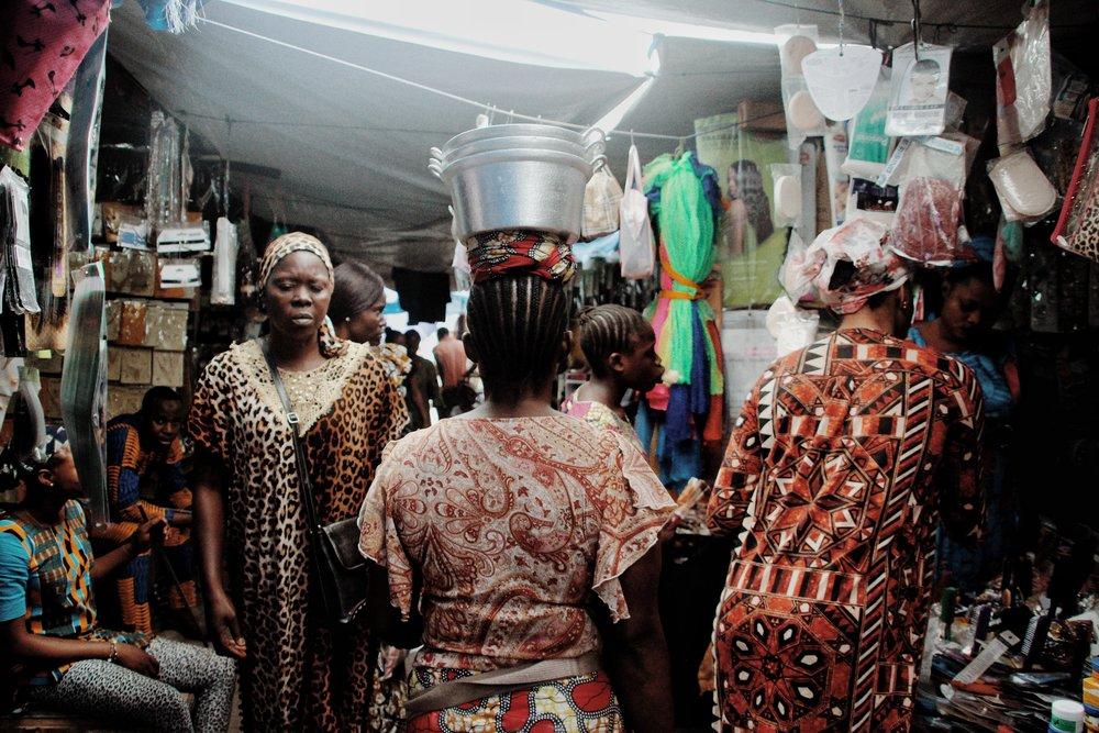 lady holding pots on head.jpeg