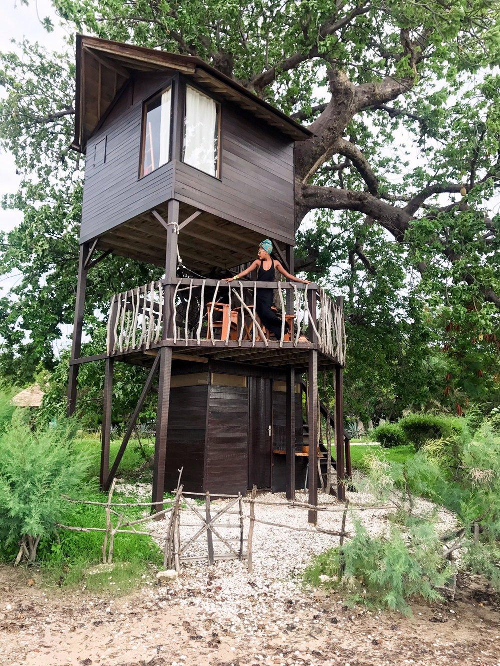 Jakiya in treehouse.JPG