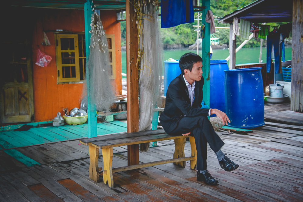 man in suit on bench.jpg