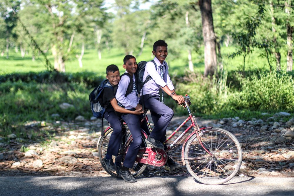 school kids on bike.jpg