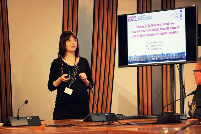 Dr Aimee Ambrose presents her findings on housing efficiency in rented properties. (Photo credit: Alice Restrict).