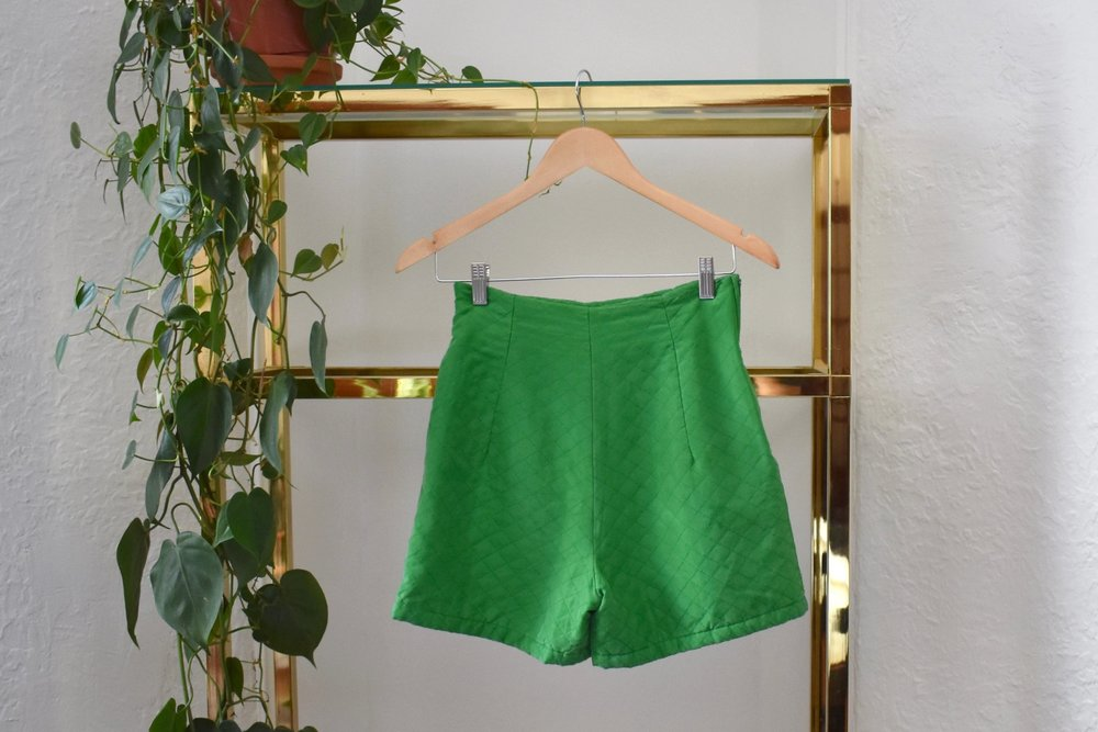 """i'm obsessed with these green silk short shorts, love the high waist, they'd look awesome dressed up or down. Someone needs to buy these."""