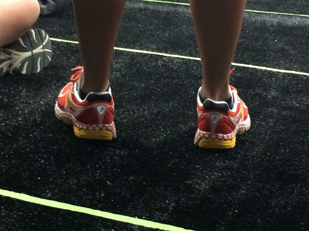 A picture of the tape outlying the rows; as well as someone wearing the special RunDisney New Balance Mickey shoes.