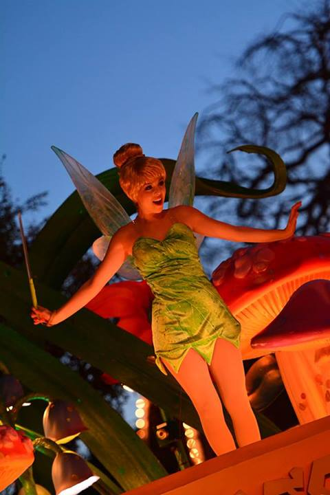 TinkerBell high above everyone else, overseeing runners in the Magic Kingdom.