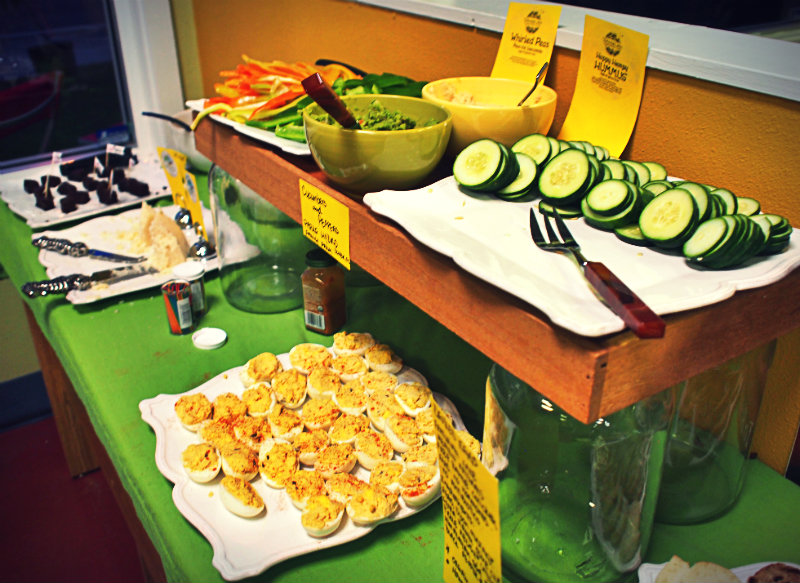 Buffet spread including Lake Meadow Naturals Deviled Eggs - Homegrown Co-op, August 2014