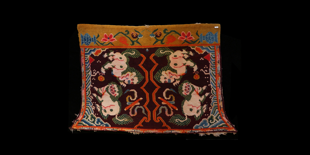 Early 20th c. Unusual Yak Saddle Rug with Snow Lion Design