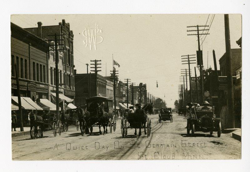 SHM 12879 - Horses, Buggies, and Cars on the 600 Block of St Germain Street, St Cloud (MN), Sept 1909.jpg