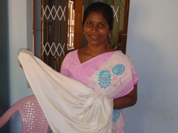 Sudha while at work in the Nano Nagel tailoring unit, 2009