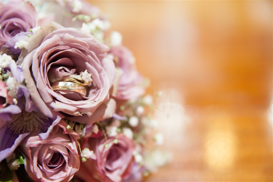How will you show off your wedding rings in your album? Hidden in a bouquet of pink roses?