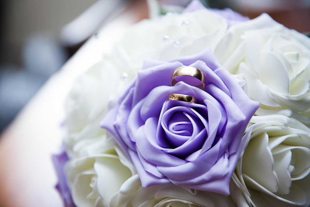 gold-wedding-rings-inside-bouquet-of-flowers.jpg