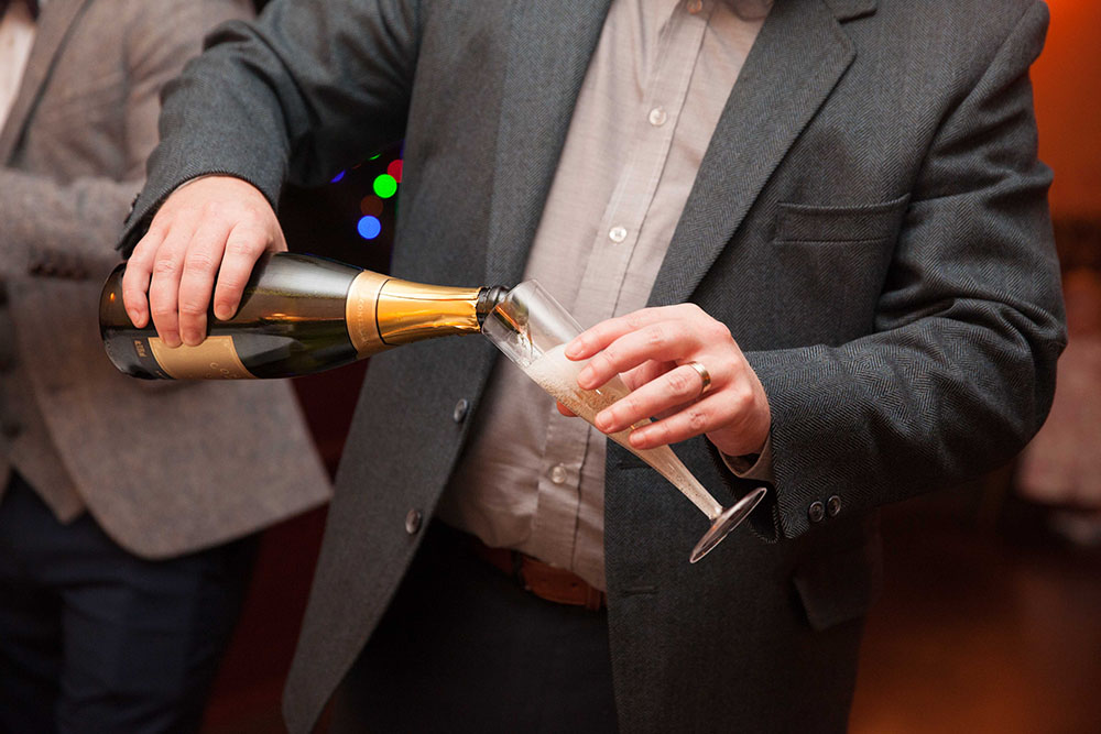 pouring-champagne-at-wedding-party.jpg