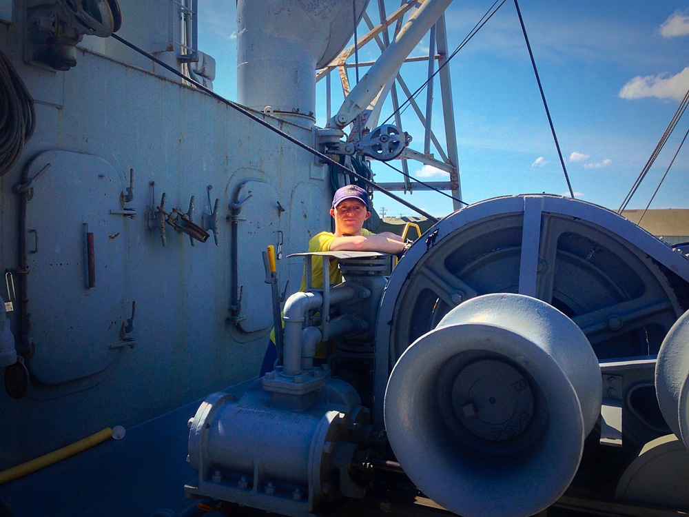 Howard's son, Andrew, is seen here during some down time between operating the ship's cargo gear. Andrew is also an active volunteer, and valued member of the crew.