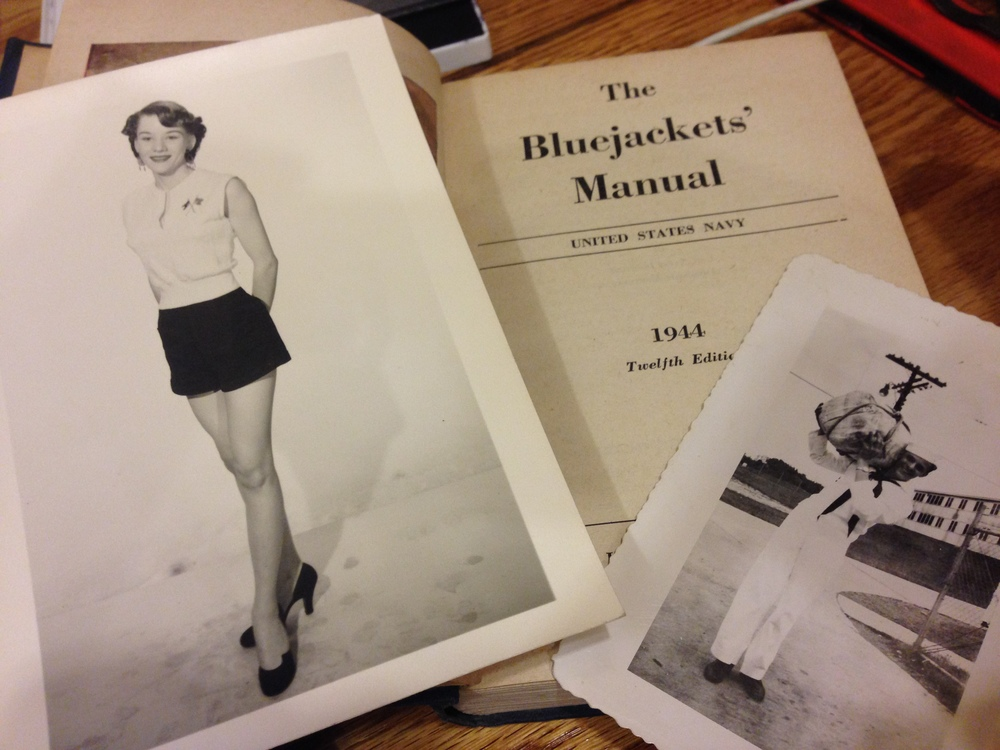 A US Navy Bluejackets' Manual, with a picture of its owner and his wife, a professional model, from 1944.