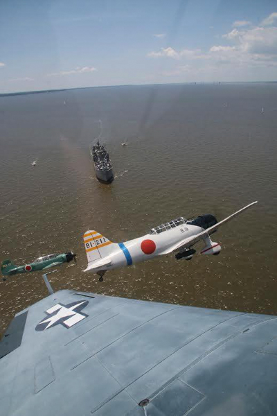 You can just see the wing tip of the Avenger, She's the Boss, here as it chases the Japanese planes away from the BROWN. Photo Credit: Stephen Chapis.