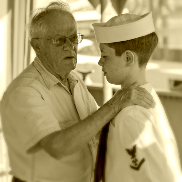 Crew member David with his grandson Holden on one of the 2013 cruises. Holden is wearing his grandfathers uniform from the war.