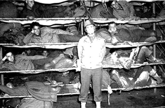 550 bunks were stacked several tiers high in some of the ships cargo holds.  A galley, a mess hall and sparse sanitation facilities were also added. I can't imagine what it was like in rough seas.