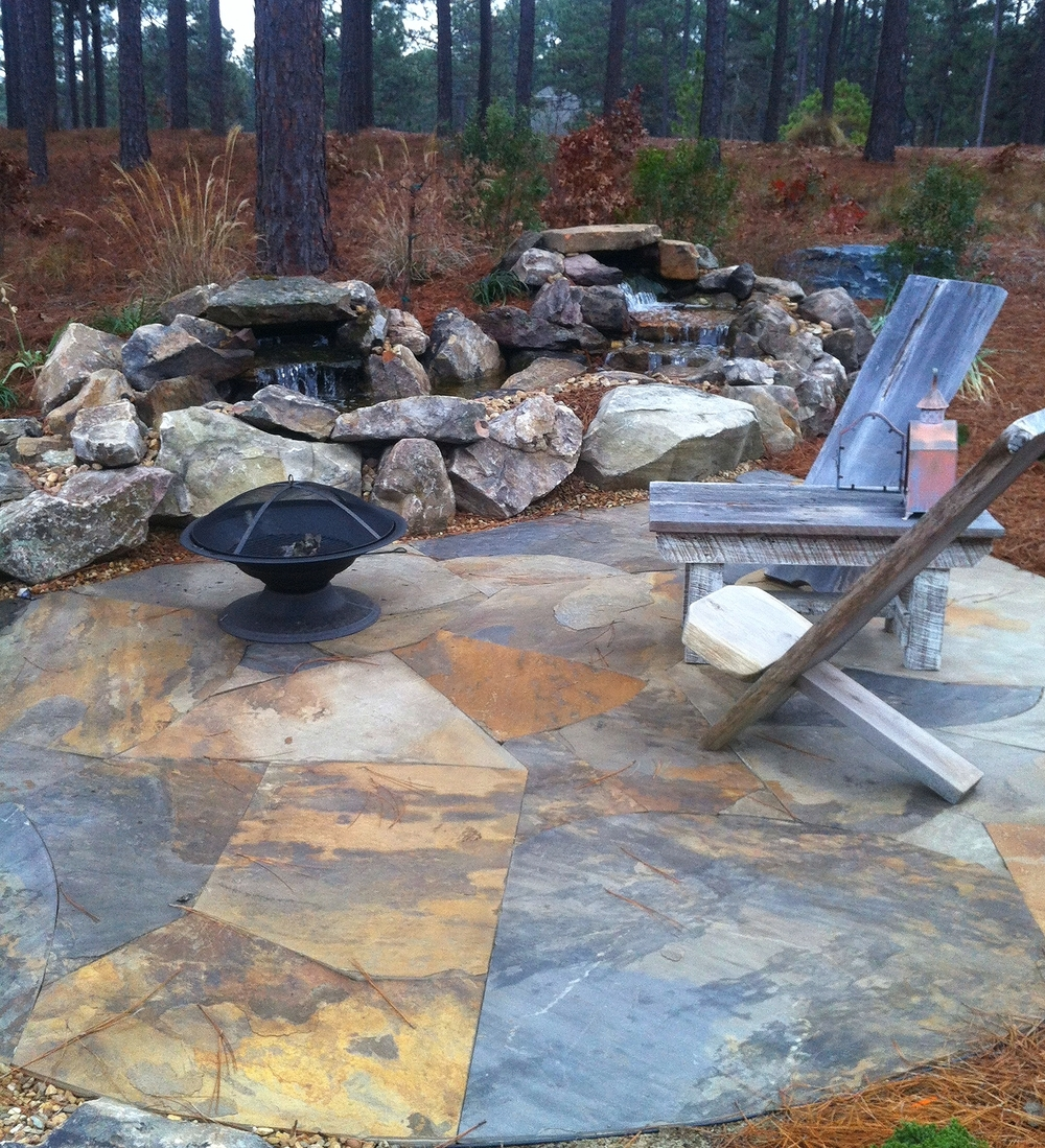 Dry laid flagstone patio frames a pondless stream