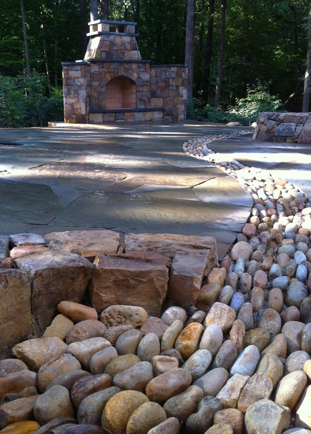 Pebble stream through a dry laid fireplace