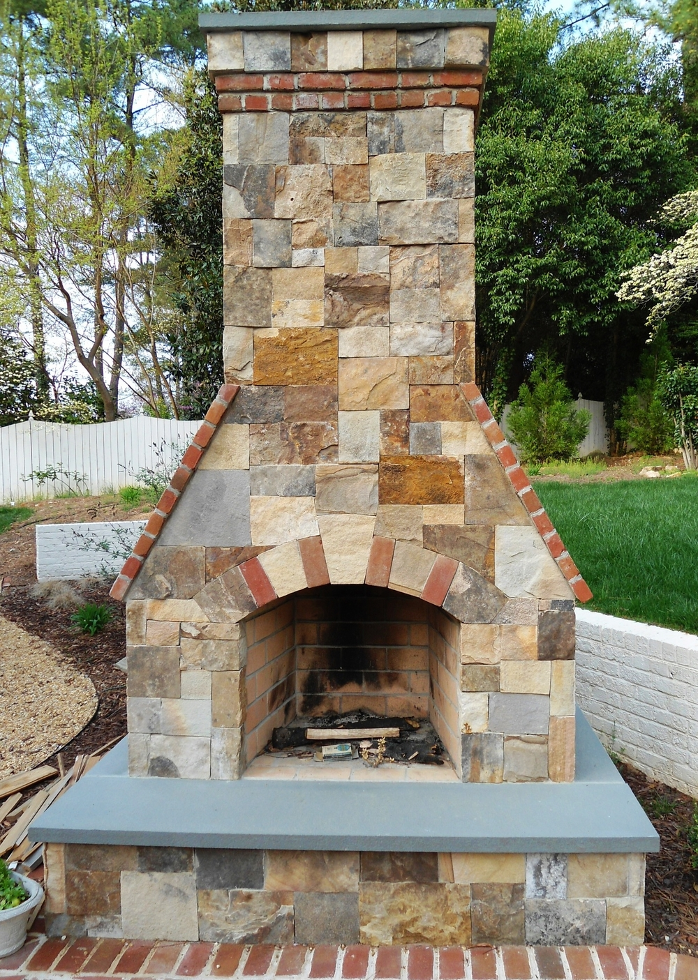 San veneer, bluestone and brick fireplace