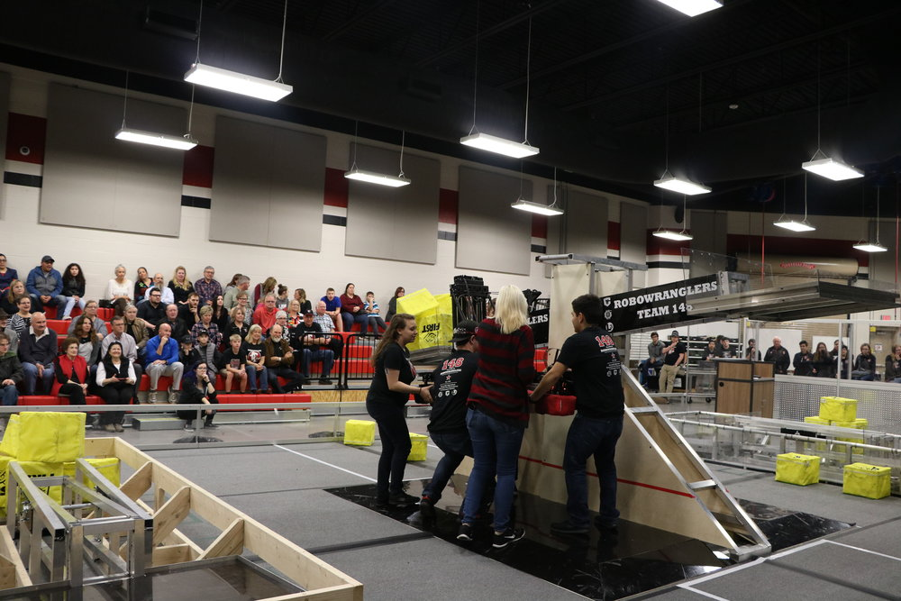 Uppercut and Bolt get pulled down after a successful Robot-Wrangler demo.