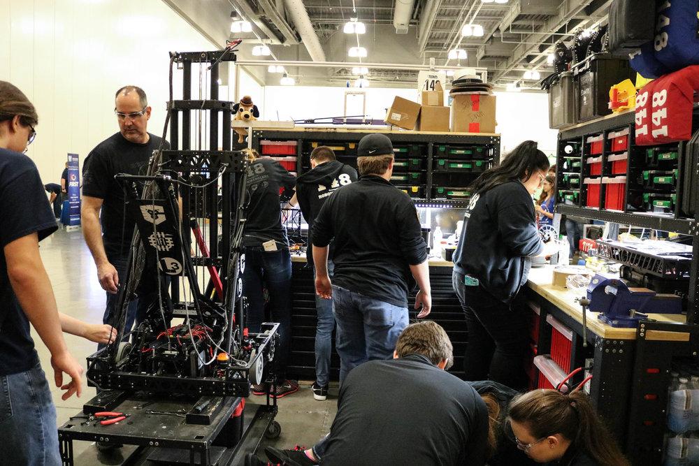 Pit crew hard at work. Mk7 Intake + Mk5 Robot Wrangler install!