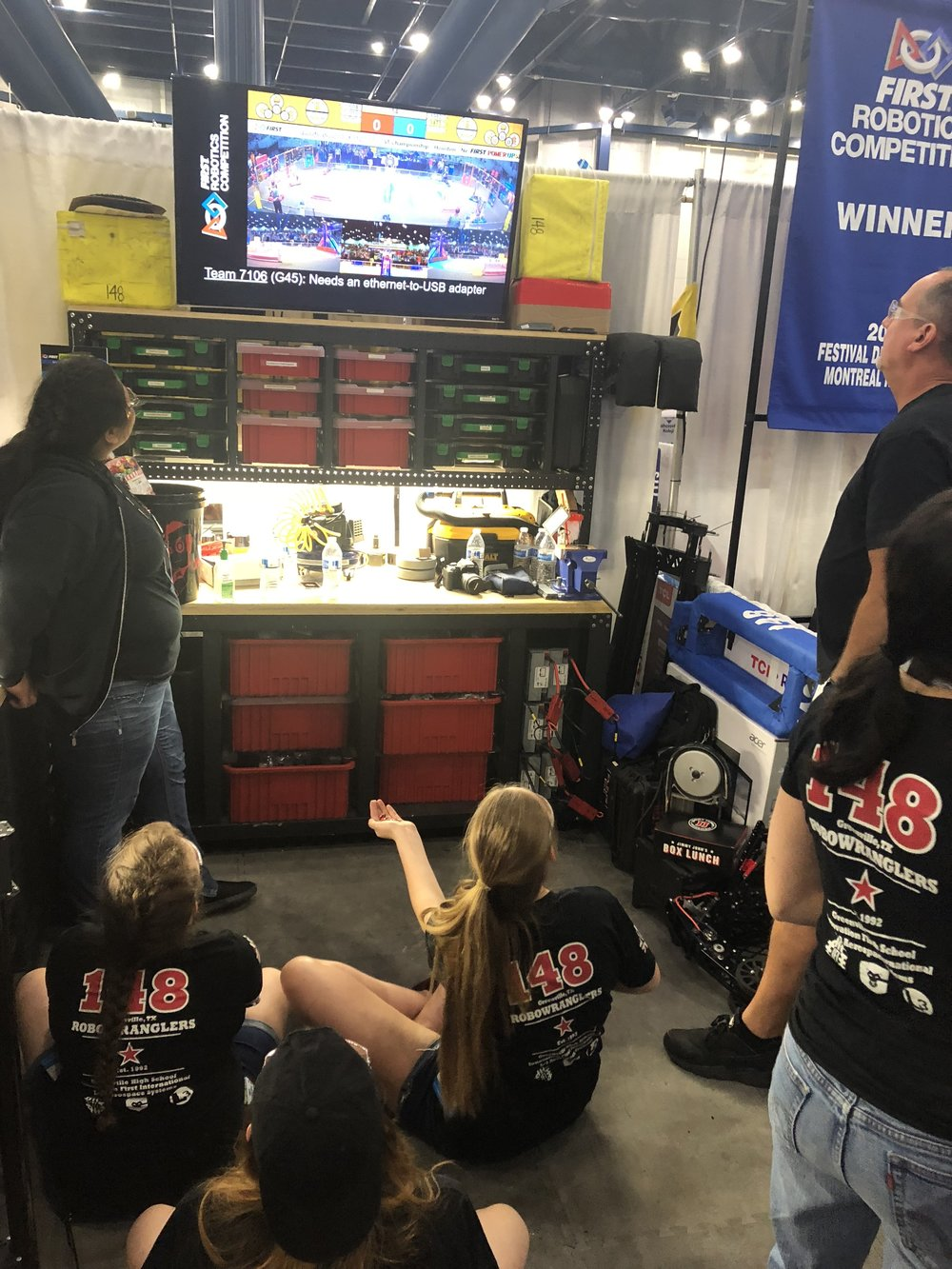 "We love the ""Pit TV"" option that FIRST gives us at the Championship. Here the Pit Crew enjoys watching our friends 7179 and 987 play together. The Robowranglers were  waiting for this match .  Did you know 7179 has a climber?!?"