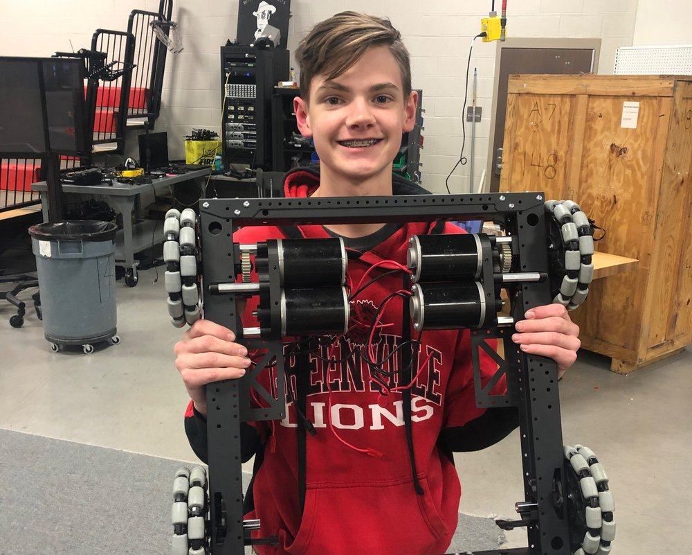 "Corbin overcomes his  ""summer working with JVN""  PTSD to pose with the partially assembled X019."