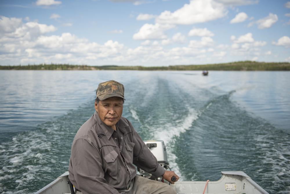 Paul Mackenzie in the boat.