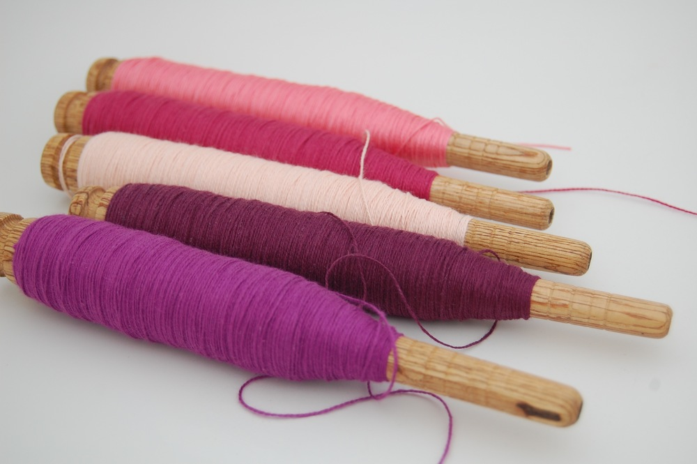 cotton wefts - magenta cotton, plum organic cotton, light peach cotton, raspberry Egyptian cotton, mercerized Egyptian Giza cotton