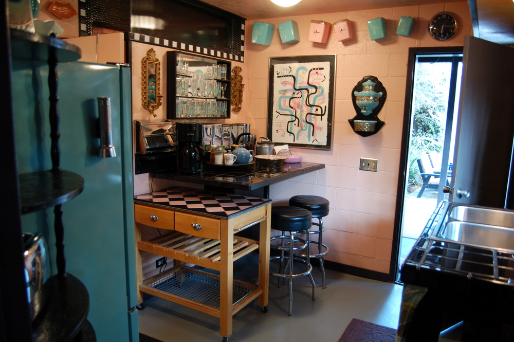 Your retro kitchen has coffee and tea and a patio right outside to enjoy it on.