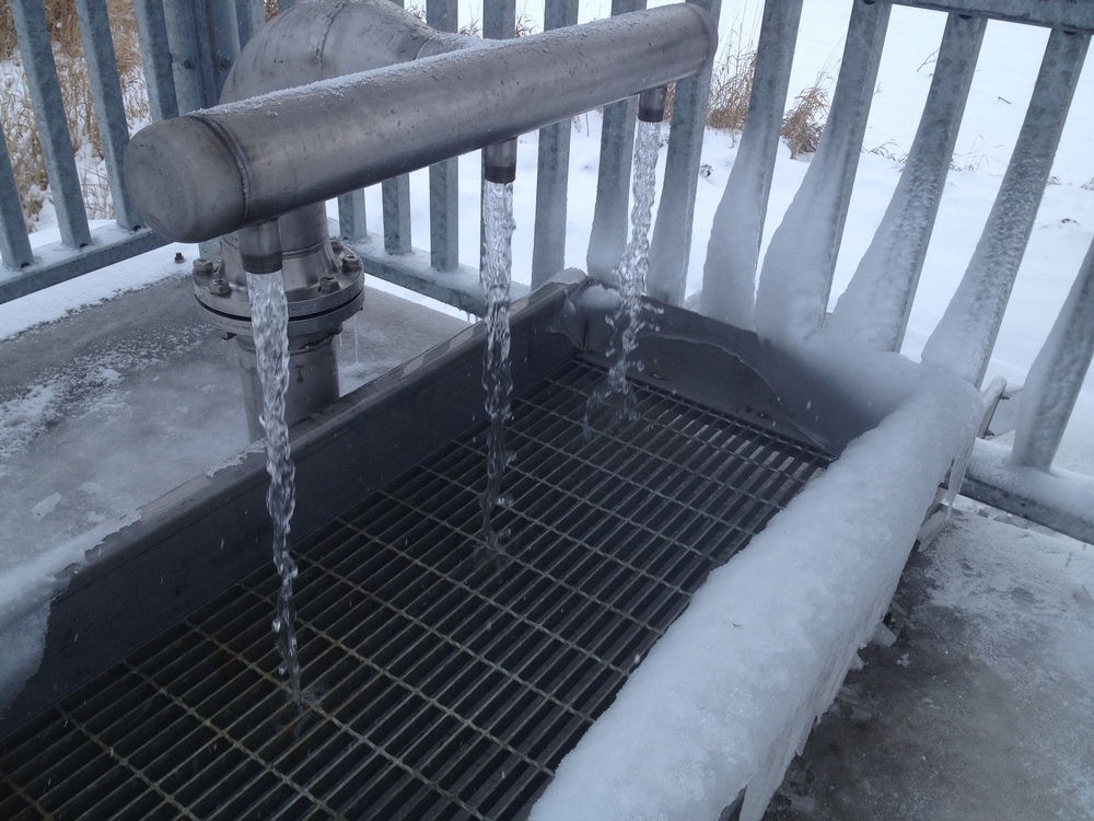 After an investment from Springwater Township, the new Elmvale Spring flow is split into three downspouts. The flow is so strong it fills your bottles faster than you can cap and carry them.