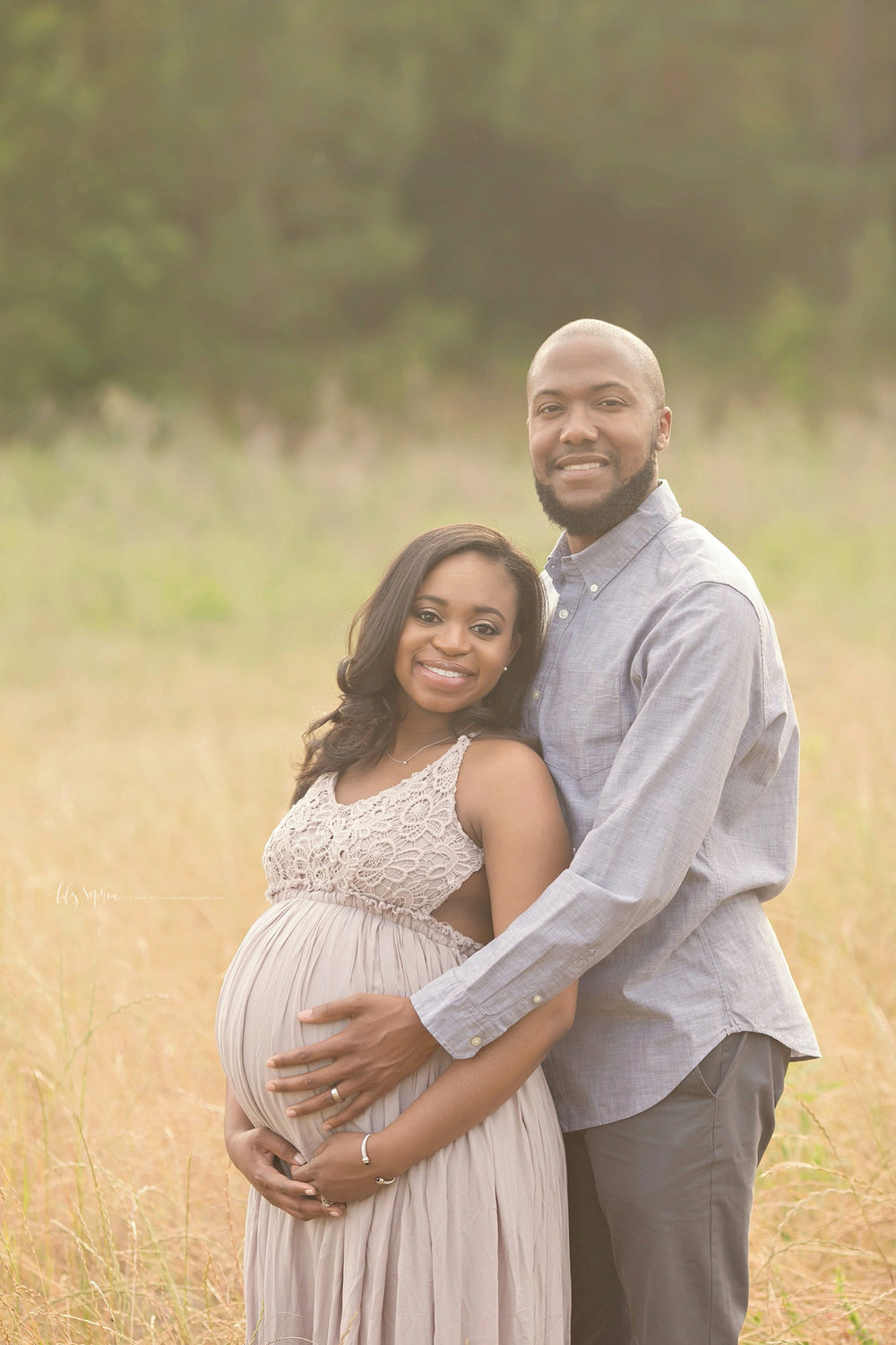 Pregnant African American Couple Expecting Baby Girl Standing In An Atlanta Field The Woman Is