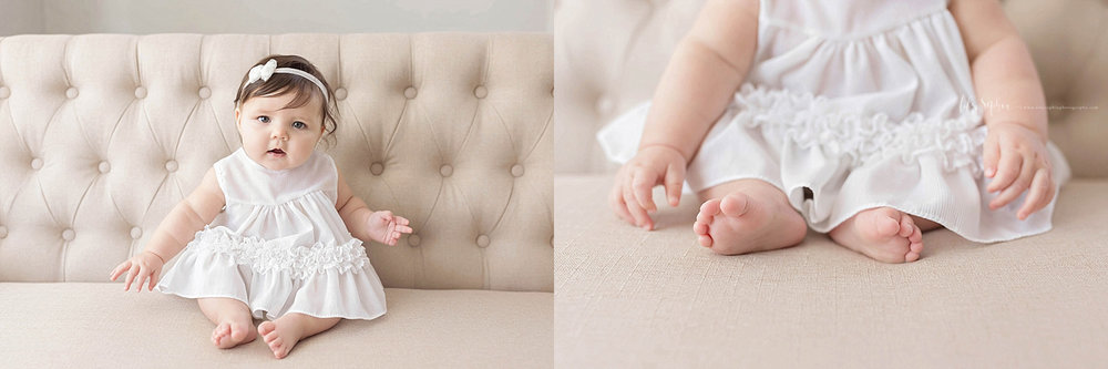 Side by side of a baby girl, wearing a white dress and bow headband, sitting on on a couch.