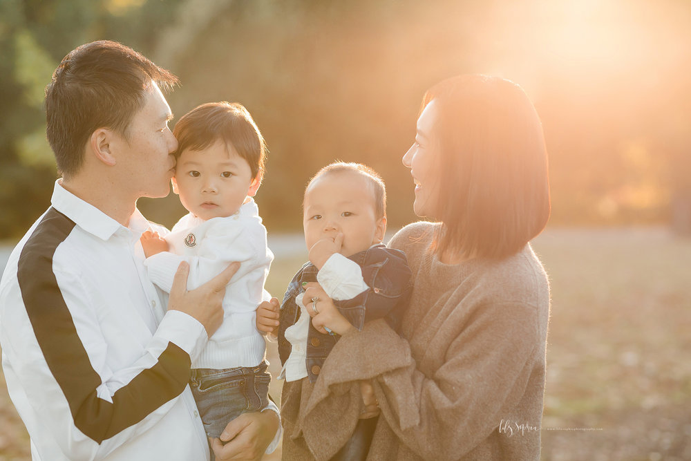 atlanta-buckhead-brookhaven-decatur-lily-sophia-photography--photographer-portraits-grant-park-intown-park-sunset-first-birthday-cake-smash-one-year-old-outdoors-cool-asian-american-family_0080.jpg