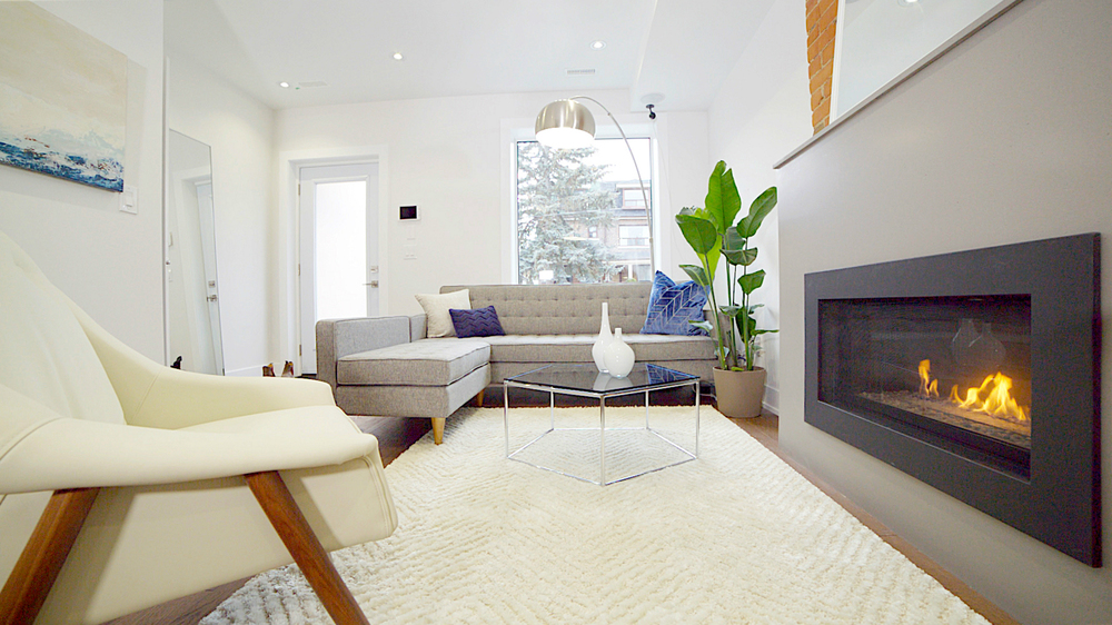 The front living room. First impressions are everything in real estate! We wanted potential buyers to envision themselves relaxing and cozying up to this lovely fire.