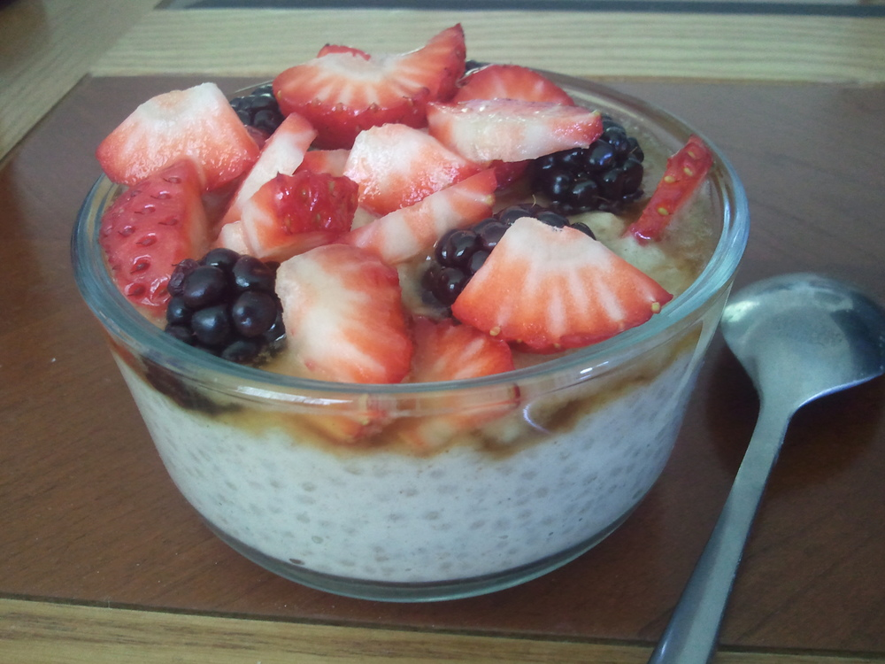Chia seed pudding topped with maple syrup & berries