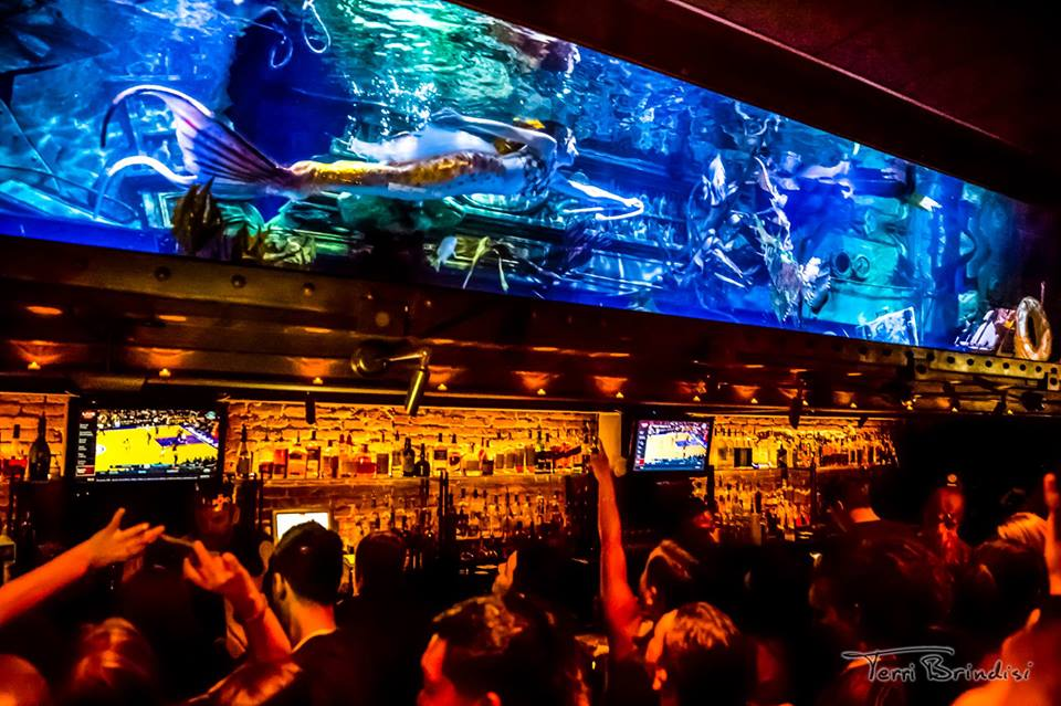 "(c)  Terri Brindisi ; Catalina Mermaid performing underwater magic tricks at  Dive Bar Sacramento  as part of  ""Coastal Carnival"""