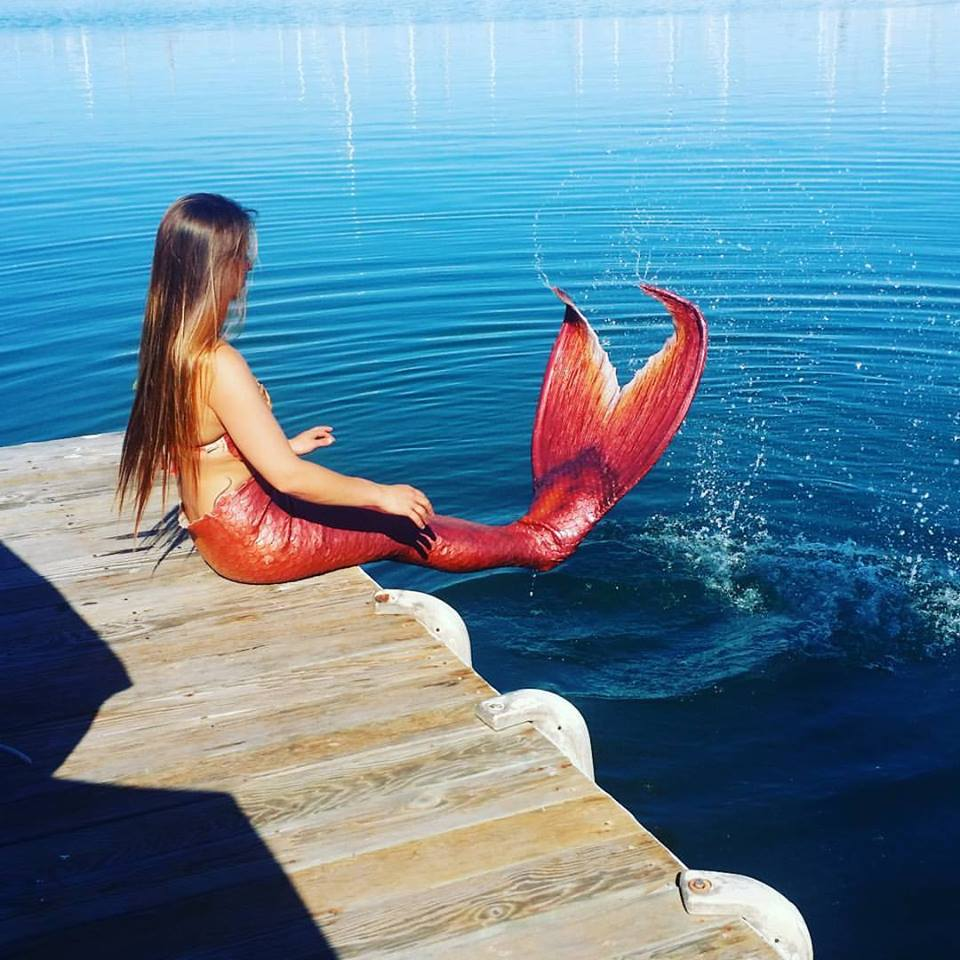 mermaid Kaia splashing tail on boat dock