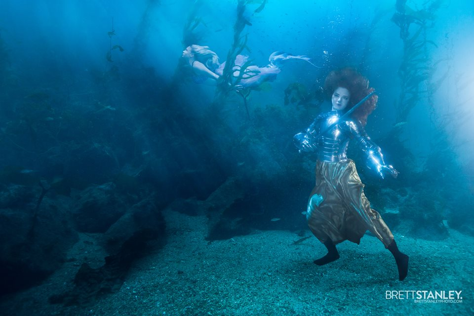 Catalina, in 35 pounds of steel plate metal armor, underwater working on set with Brett Stanley, photographer