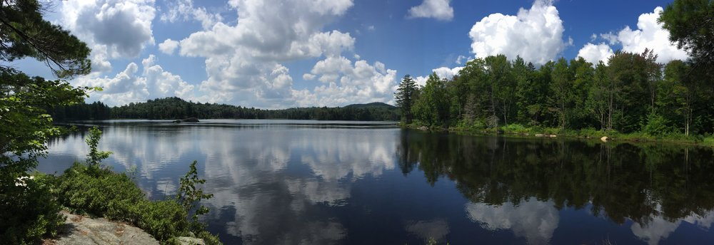 BillHahn-HighAdventure-LakeForestAndCloudsReflecting-Panorama.JPG