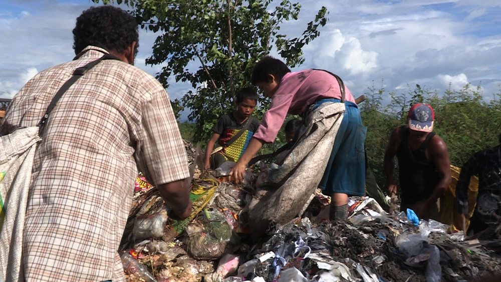 Children have to work picking through garbage to supplement their family income