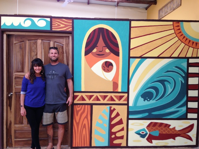 Nellie and Erik Abel in front of the Nicaragua Mural at the Playa Gigante Health Center in 2014