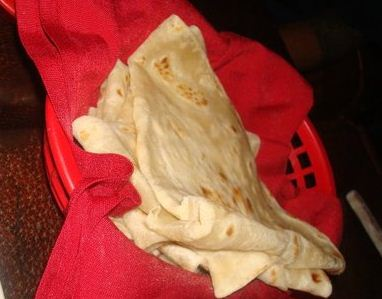 A basket of freshly made flour tortillas served alongside our meal at Paco's Tacos in Los Angeles.