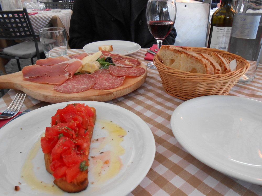 Enjoy a glass of wine along with some meats and cheeses in one of the many piazzas throughout the city.